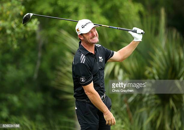 Alex Cejka of Germany tees off on the 11th hole during a continuation of the first round of the Zurich Classic of New Orleans at TPC Louisiana on...