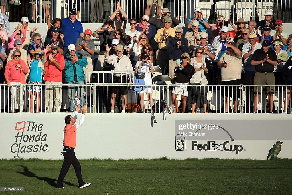 Alex Cejka of Germany walks to the 17th green following a hole in one during the first round of the Honda Classic at PGA National Resort Spa...