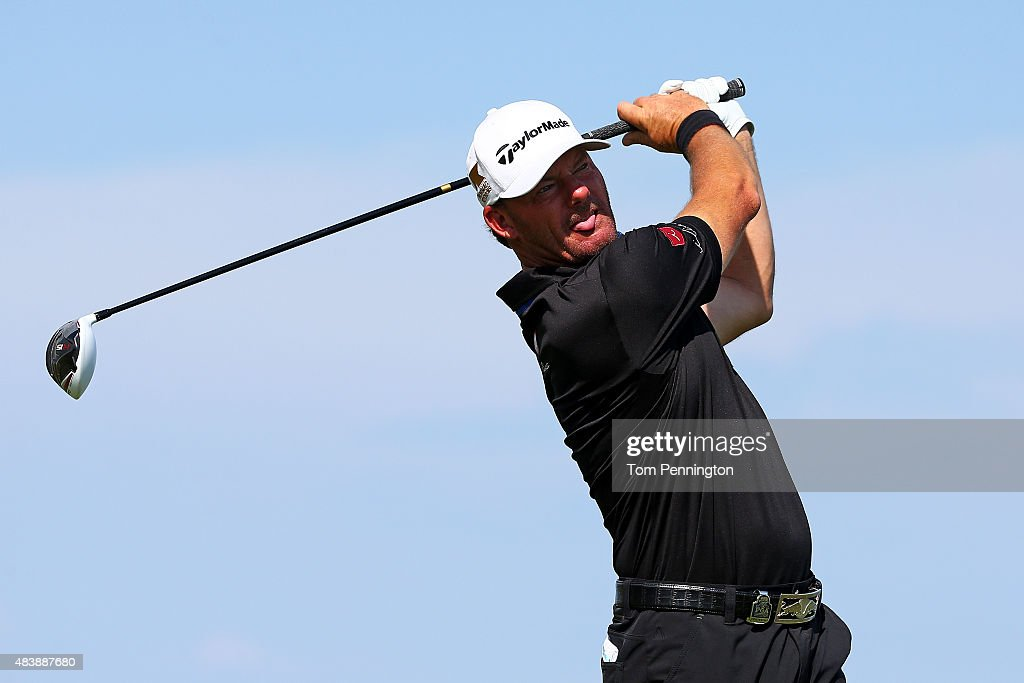 Alex Cejka of Germany watches his tee shot on the 14th hole during the first round of the 2015 PGA Championship at Whistling Straits on August 13...
