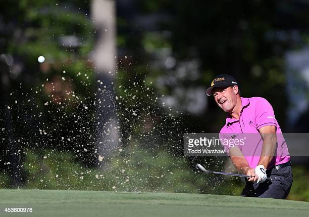 Alex Cejka of the Czech Republic chips onto the green on the 13th hole during the first round of the Wyndham Championship at Sedgefield Country Club...