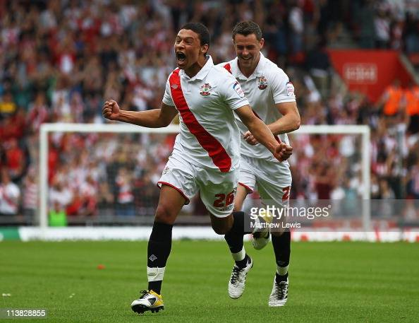 Alex Chamberlain of Southampton celebrates his goal with team mate Frazer Richardson during the npower League One match between Southampton and...
