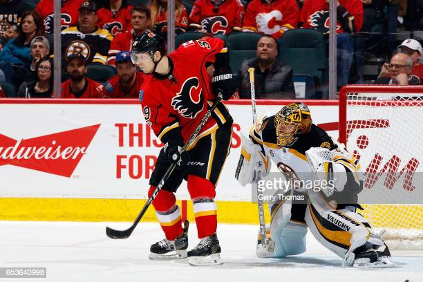 Alex Chiasson of the Calgary Flames skates against Anton Khudobin of the Boston Bruins during an NHL game on March 15 2017 at the Scotiabank...