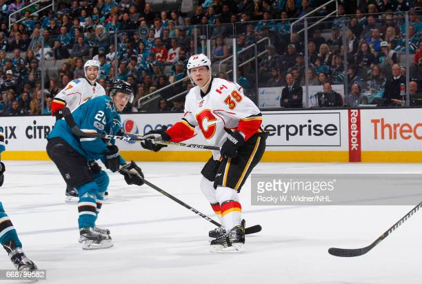 Alex Chiasson of the Calgary Flames skates against Marcus Sorensen of the San Jose Sharks at SAP Center on April 8 2017 in San Jose California