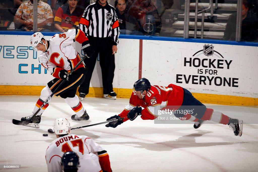 Alex Chiasson #39 of the Calgary Flames skates away with the puck against Jonathan Marchessault #81 of the Florida Panthers at the BB&T Center on February 24, 2017 in Sunrise, Florida.
