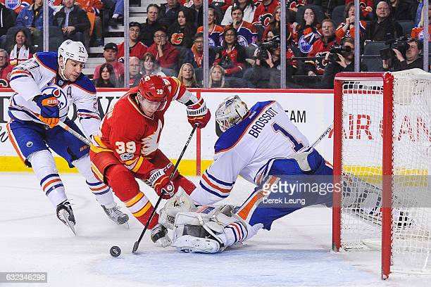 Alex Chiasson of the Calgary Flames takes a shot on Laurent Brossoit of the Edmonton Oilers during an NHL game at Scotiabank Saddledome on January 21...