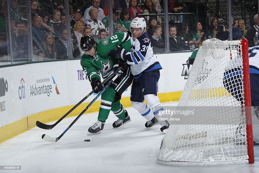 <a gi-track='captionPersonalityLinkClicked' href=/galleries/search?phrase=Alex+Chiasson&family=editorial&specificpeople=5894597 ng-click='$event.stopPropagation()'>Alex Chiasson</a> #12 of the Dallas Stars battles behind the nets against <a gi-track='captionPersonalityLinkClicked' href=/galleries/search?phrase=Tobias+Enstrom&family=editorial&specificpeople=2538468 ng-click='$event.stopPropagation()'>Tobias Enstrom</a> #39 of the Winnipeg Jets at the American Airlines Center on March 24, 2014 in Dallas, Texas.