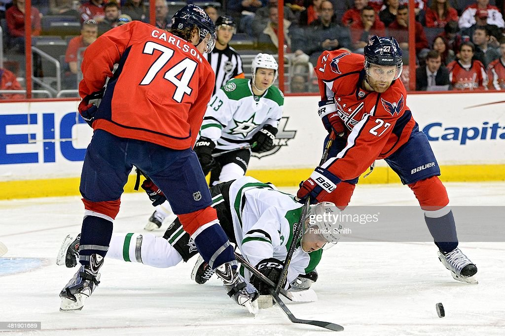 <a gi-track='captionPersonalityLinkClicked' href=/galleries/search?phrase=Alex+Chiasson&family=editorial&specificpeople=5894597 ng-click='$event.stopPropagation()'>Alex Chiasson</a> #12 of the Dallas Stars is checked by <a gi-track='captionPersonalityLinkClicked' href=/galleries/search?phrase=Karl+Alzner&family=editorial&specificpeople=3938829 ng-click='$event.stopPropagation()'>Karl Alzner</a> #27 of the Washington Capitals in the second period during an NHL game at Verizon Center on April 1, 2014 in Washington, DC.