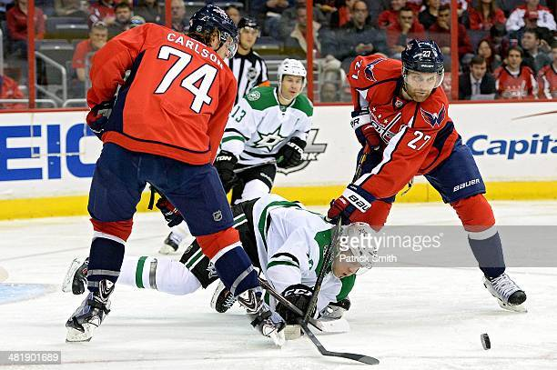 Alex Chiasson of the Dallas Stars is checked by Karl Alzner of the Washington Capitals in the second period during an NHL game at Verizon Center on...