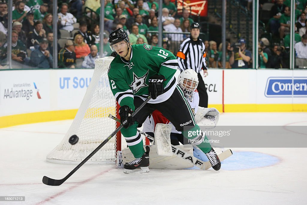 <a gi-track='captionPersonalityLinkClicked' href=/galleries/search?phrase=Alex+Chiasson&family=editorial&specificpeople=5894597 ng-click='$event.stopPropagation()'>Alex Chiasson</a> #12 of the Dallas Stars skates the puck against the Florida Panthers at American Airlines Center on October 3, 2013 in Dallas, Texas.