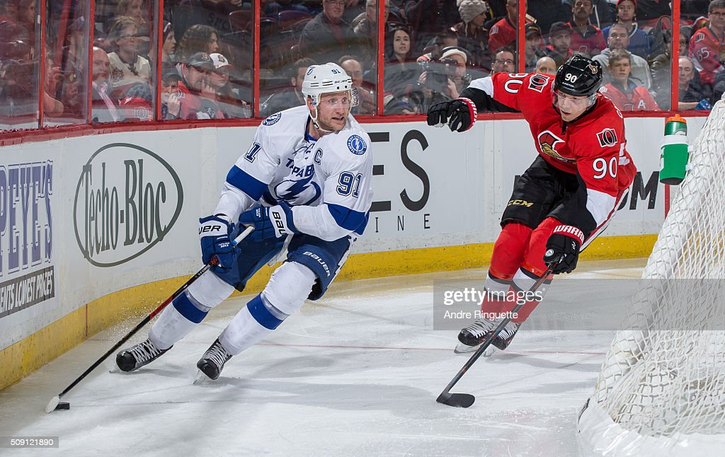 <a gi-track='captionPersonalityLinkClicked' href=/galleries/search?phrase=Alex+Chiasson&family=editorial&specificpeople=5894597 ng-click='$event.stopPropagation()'>Alex Chiasson</a> #90 of the Ottawa Senators chases as <a gi-track='captionPersonalityLinkClicked' href=/galleries/search?phrase=Steven+Stamkos&family=editorial&specificpeople=4047623 ng-click='$event.stopPropagation()'>Steven Stamkos</a> #91 of the Tampa Bay Lightning stickhandles the puck behind the net at Canadian Tire Centre on February 8, 2016 in Ottawa, Ontario, Canada.
