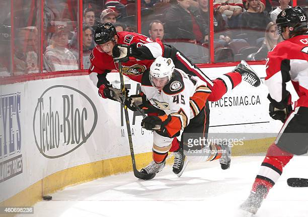 Alex Chiasson of the Ottawa Senators collides with Sami Vatanen of the Anaheim Ducks along the end boards at Canadian Tire Centre on December 19 2014...