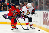 Alex Chiasson of the Ottawa Senators digs the puck out from the boards against Brian Campbell of the Florida Panthers at the BBT Center on October 13...