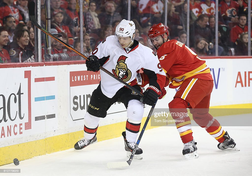 Alex Chiasson #90 of the Ottawa Senators goes after the puck during their NHL game against Mark Giordano #5 of the Calgary Flames at the Scotiabank Saddledome on February 27, 2016 in Calgary, Alberta, Canada.