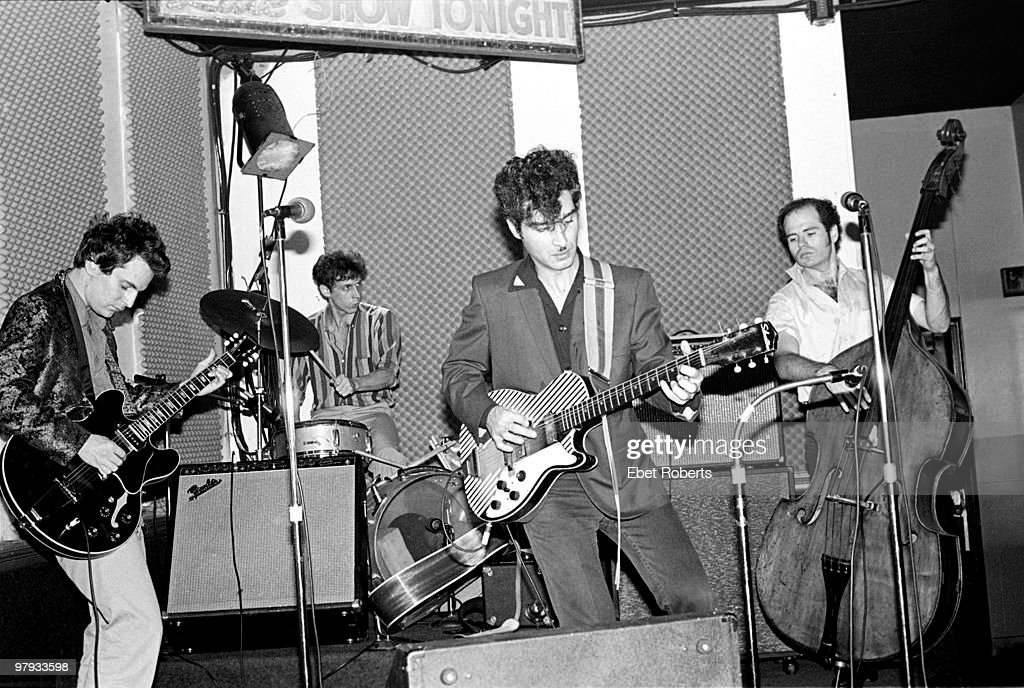 <a gi-track='captionPersonalityLinkClicked' href=/galleries/search?phrase=Alex+Chilton&family=editorial&specificpeople=1674278 ng-click='$event.stopPropagation()'>Alex Chilton</a> (left) performing live on stage with Tav Falco (centre) and the Panther Burns at SNAFU in New York City on September 211980