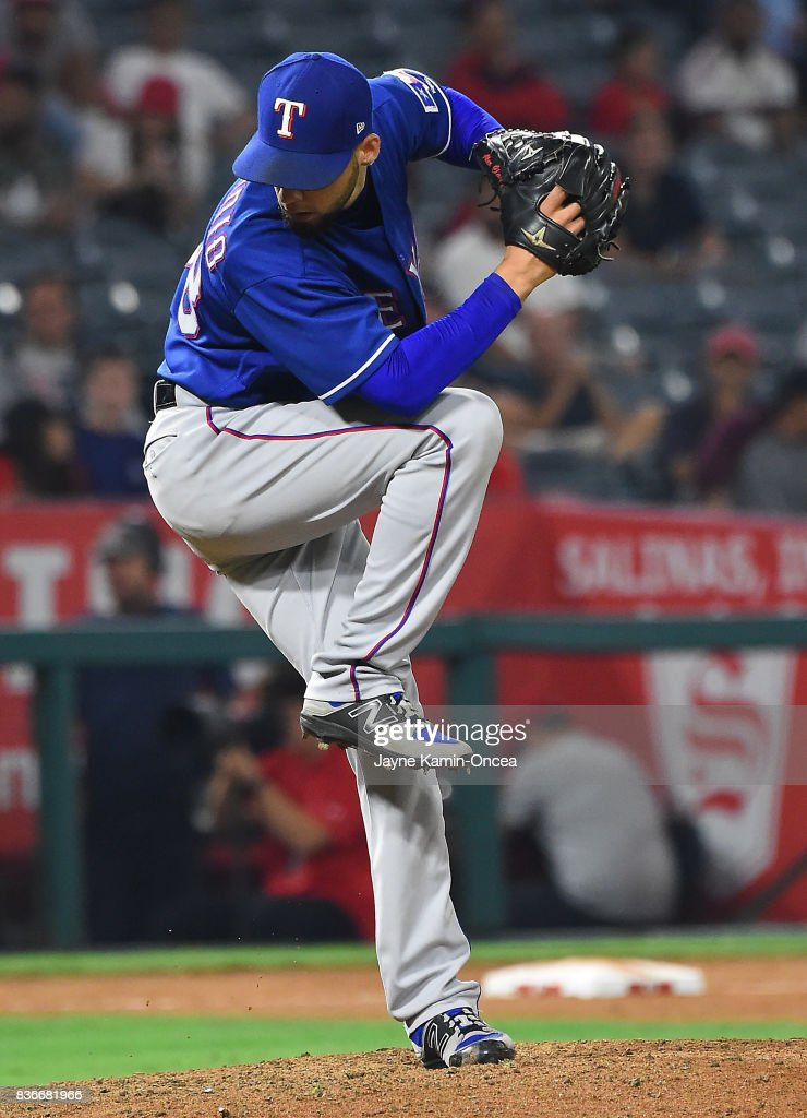 Alex Claudio #58 of the Texas Rangers earns a save in the ninth inning of the game against the Los Angeles Angels of Anaheim at Angel Stadium of Anaheim on August 21, 2017 in Anaheim, California.