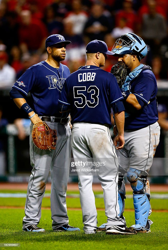 Alex Cobb #53 of the Tampa Bay Rays talks with Jose Molina #28 and James Loney #21 against the Cleveland Indians during the American League Wild Card game at Progressive Field on October 2, 2013 in Cleveland, Ohio.