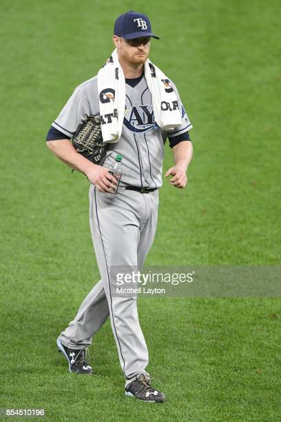 Alex Cobb of the Tampa Bay Rays walks to the dug out before a baseball game against the Baltimore Orioles at Oriole Park at Camden Yards on September...