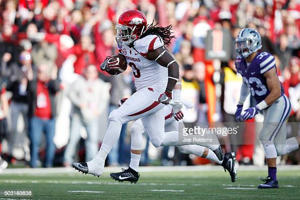 Alex Collins of the Arkansas Razorbacks breaks free for a 22yard touchdown run against the Kansas State Wildcats in the first quarter of the AutoZone...
