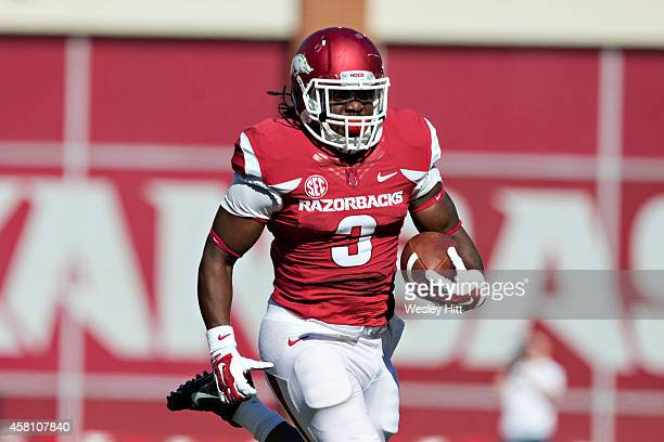 Alex Collins of the Arkansas Razorbacks runs the ball against the UAB Blazers at Razorback Stadium on October 25 2014 in Fayetteville Arkansas The...