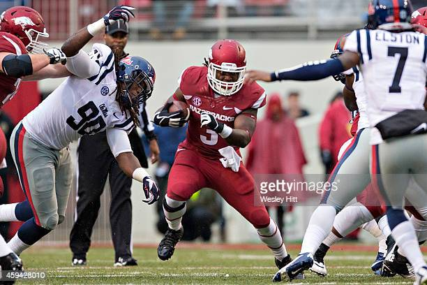 Alex Collins of the Arkansas Razorbacks runs the ball in the second quarter during a game against the Ole Miss Rebels at Razorback Stadium on...