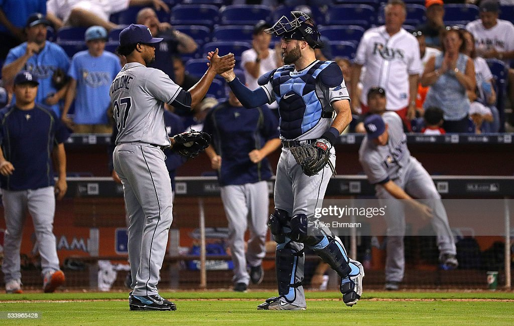 Alex Colome #37 and Curt Casali #19 of the Tampa Bay Rays high five after winning a game against the Miami Marlins at Marlins Park on May 24, 2016 in Miami, Florida.