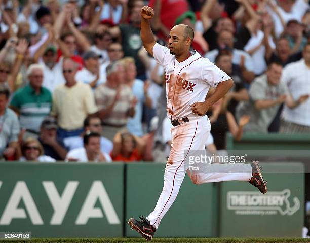 Alex Cora of the Boston Red Sox celebrates as he scores the game winning run in the ninth inninng against the Baltimore Orioles on September 3 2008...