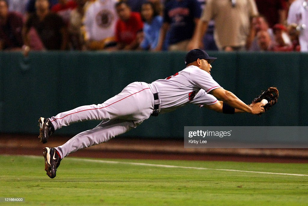 Alex Cora of the Boston Red Sox makes a diving catch during 4-3 victory in 10 innings over the Los Angeles Angels of Anaheim at Angel Stadium in Anaheim, Calif. on Friday, August 19, 2005.