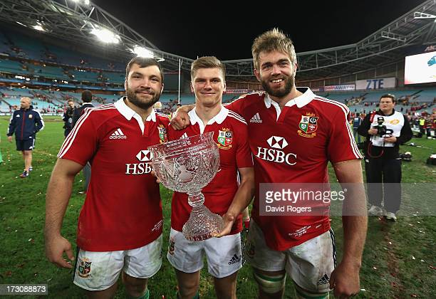 Alex Corbisiero Owen Farrell and Geoff Parling hold the Tom Richards Cup as they celebrate after their victory during the International Test match...