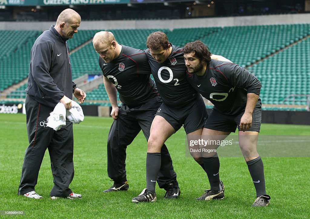 Alex Corbisiero,(R) who will replace the injured Andrew Sheridan in the front row receives instructions from front row coach <a gi-track='captionPersonalityLinkClicked' href=/galleries/search?phrase=Graham+Rowntree&family=editorial&specificpeople=215047 ng-click='$event.stopPropagation()'>Graham Rowntree</a> (L) with <a gi-track='captionPersonalityLinkClicked' href=/galleries/search?phrase=Dylan+Hartley&family=editorial&specificpeople=764177 ng-click='$event.stopPropagation()'>Dylan Hartley</a> and <a gi-track='captionPersonalityLinkClicked' href=/galleries/search?phrase=Dan+Cole&family=editorial&specificpeople=4166468 ng-click='$event.stopPropagation()'>Dan Cole</a>(2nd R) during the England training session held at Twickenham Stadium on February 11, 2011 in Twickenham, England.
