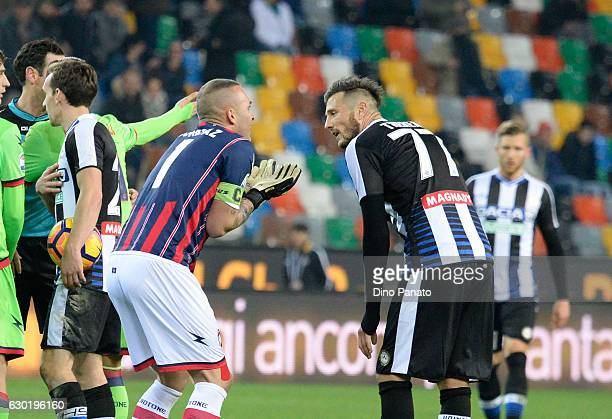 Alex Cordaz goalkeeper of FC Crotone rects after receves red card with Cyril Thereau of Udinese Calcio during the Serie A match between Udinese...