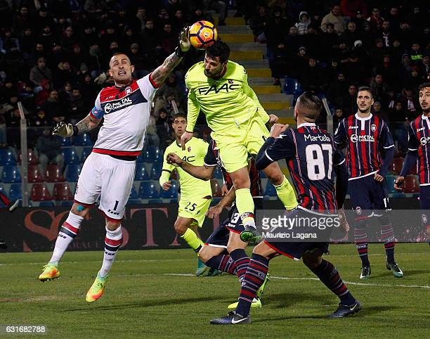 Alex Cordaz of Crotone competes for the ball with Mattia Destro of Bologna during the Serie A match between FC Crotone and Bologna FC at Stadio...