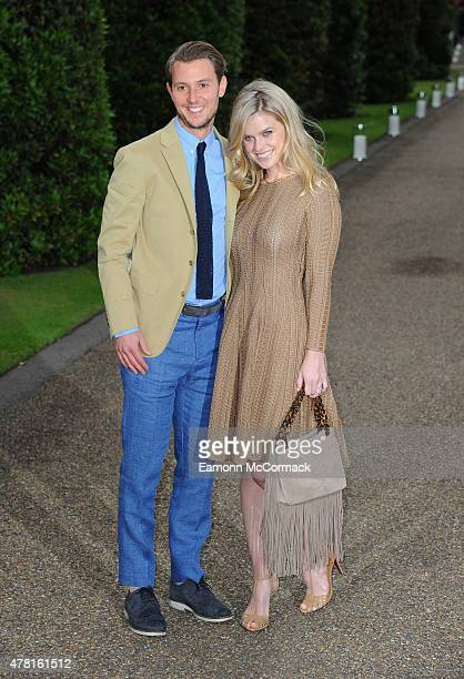 Alex CowperSmith and Alice Eve attend the Vogue and Ralph Lauren Wimbledon party at The Orangery on June 22 2015 in London England