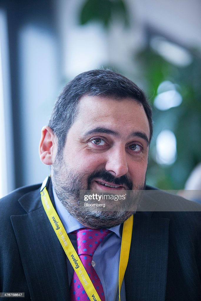 Alex Cruz, chief executive officer of Vueling Airlines SA, the low-cost carrier operated by International Airlines Group SA (IAG SA), speaks during an interview at the ITB Berlin tourism fair at Messe Berlin exhibition center in Berlin, Germany, on Wednesday, March 5, 2014. Vueling delivered a 25 percent operating margin in the third quarter of 2013, almost double the figure at British Airways, propelling parent IAG SA to a 690 million-euro ($925 million) operating profit. Photographer: Krisztian Bocsi/Bloomberg via Getty Images