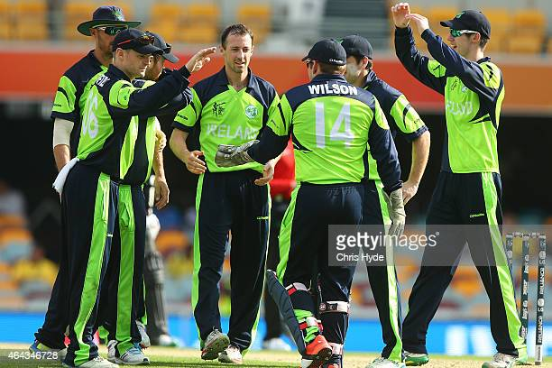 Alex Cusack of Ireland celebrates a wicket during the 2015 ICC Cricket World Cup match between Ireland and the United Arab Emirates at The Gabba on...