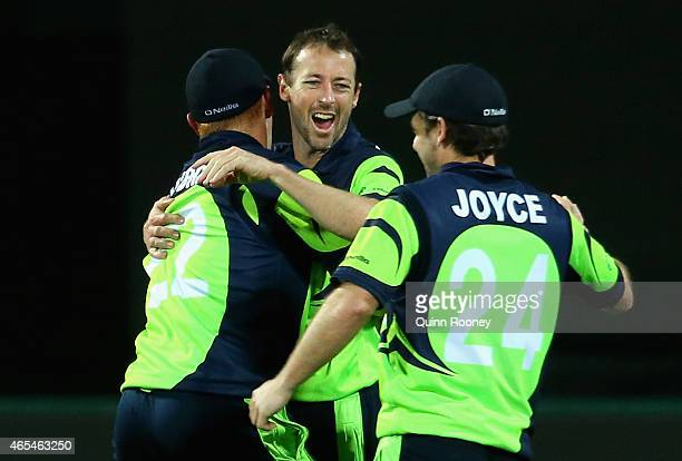 Alex Cusack of Ireland is congratulated by team mates after getting the wicket of Tawanda Mupariwa of Zimbabwe to win the 2015 ICC Cricket World Cup...