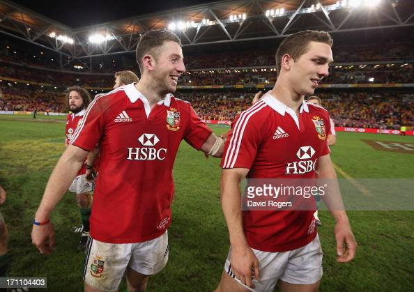Alex Cuthbert and George North who scored the Lions tries celebrate their victory during the First Test match between the Australian Wallabies and...