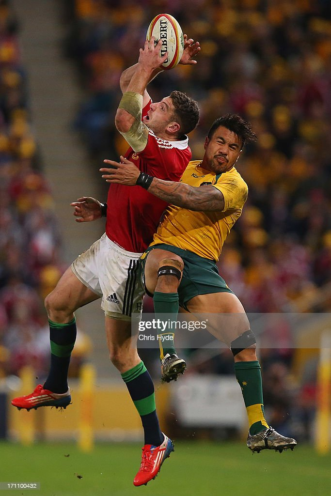 Alex Cuthbert of the British Irish Lions catches the ball whilst tackled by Digby Ioane of the Wallabies during the First Test match between the...