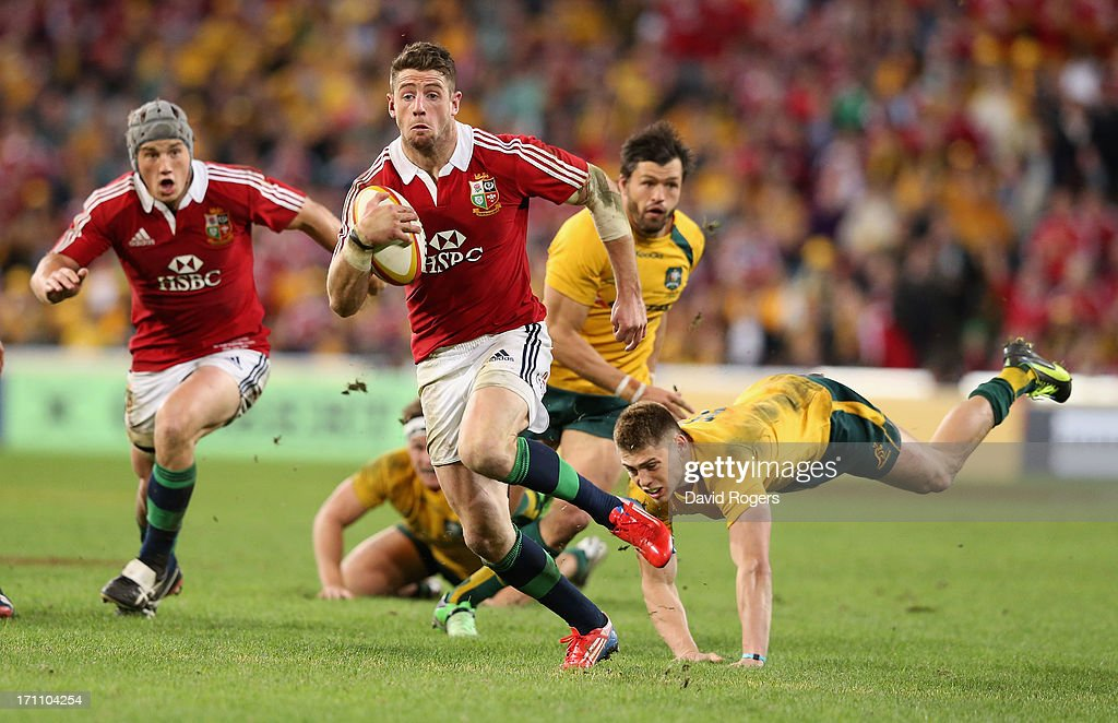 Alex Cuthbert of the Lions breaks clear from James O'Connor to score the Lions second try during the First Test match between the Australian...
