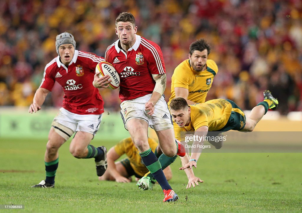 Alex Cuthbert of the Lions breaks clear to score the Lions second try during the First Test match between the Australian Wallabies and the British...
