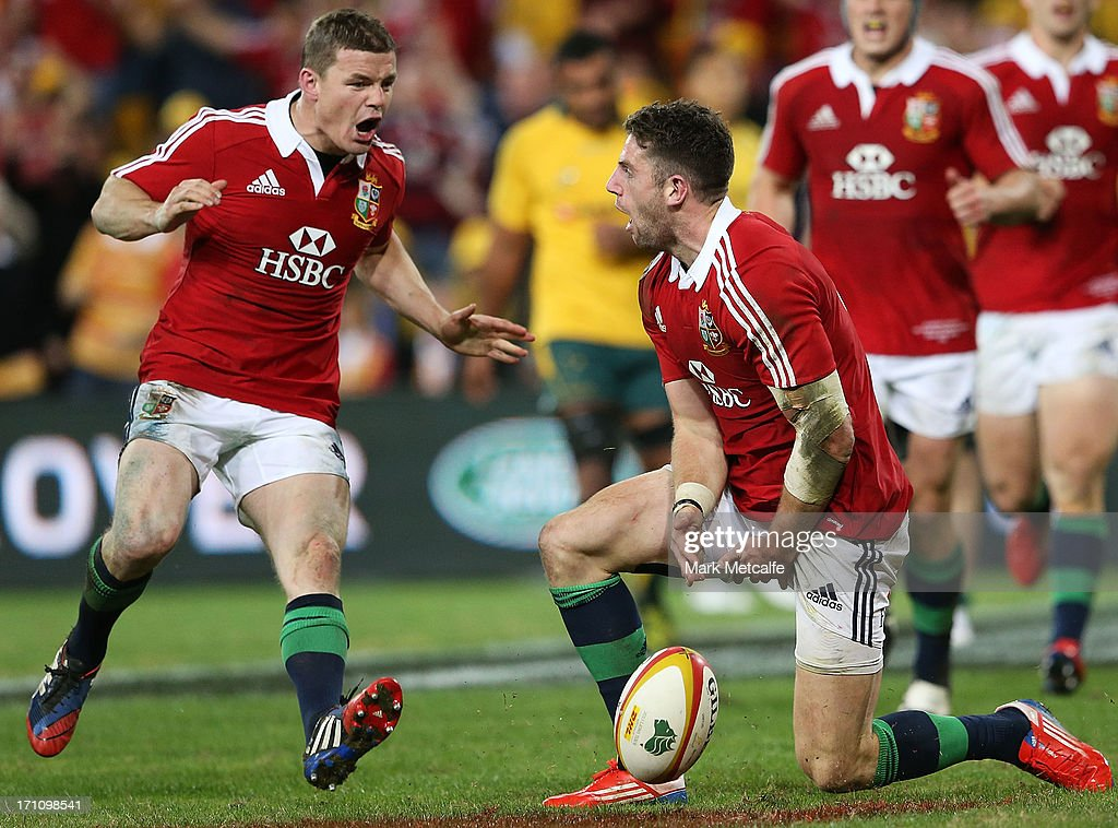 Alex Cuthbert of the Lions celebrates scoring a try with teammate Brian O'Driscoll during the First Test match between the Australian Wallabies and...