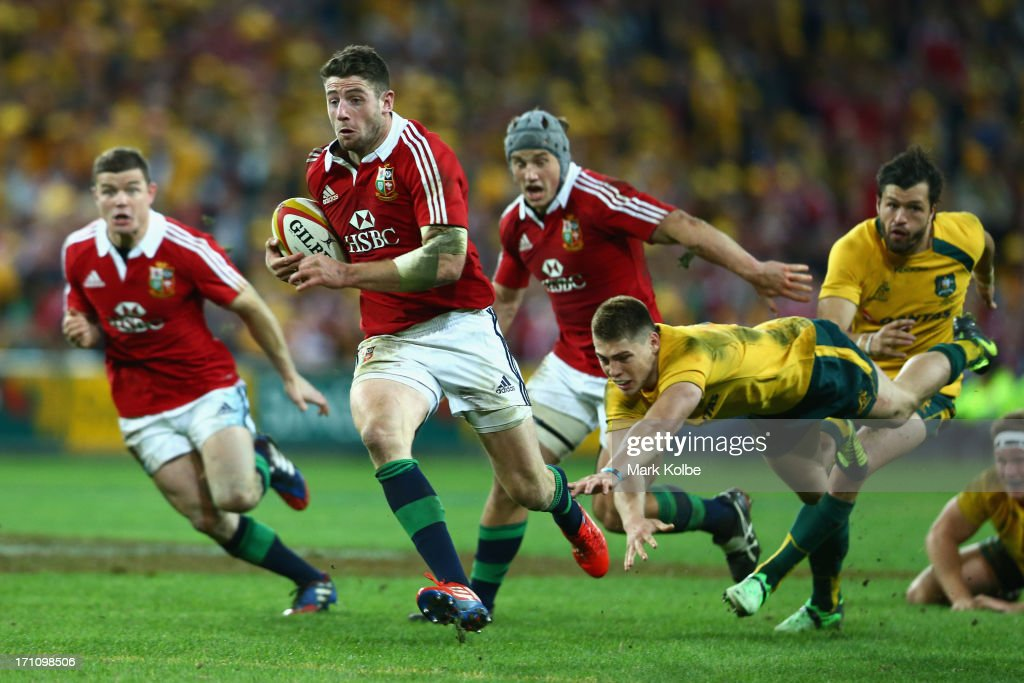 Alex Cuthbert of the Lions makes a break on his way to scoring a try during the First Test match between the Australian Wallabies and the British...