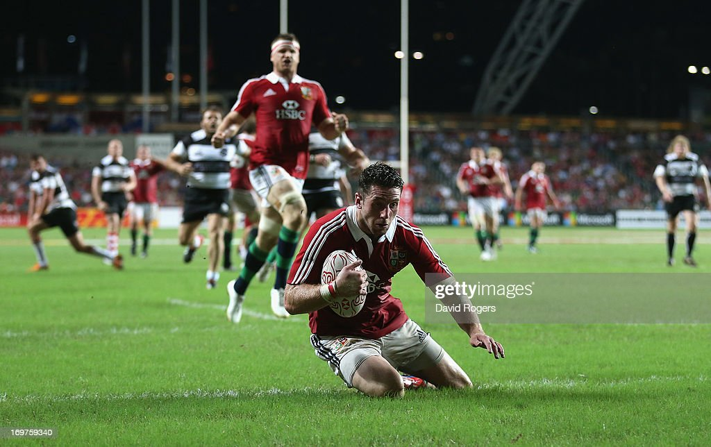 Alex Cuthbert of the Lions scores his second try during the match between the British Irish Lions and the Barbarians at Hong Kong Stadium on June 1...