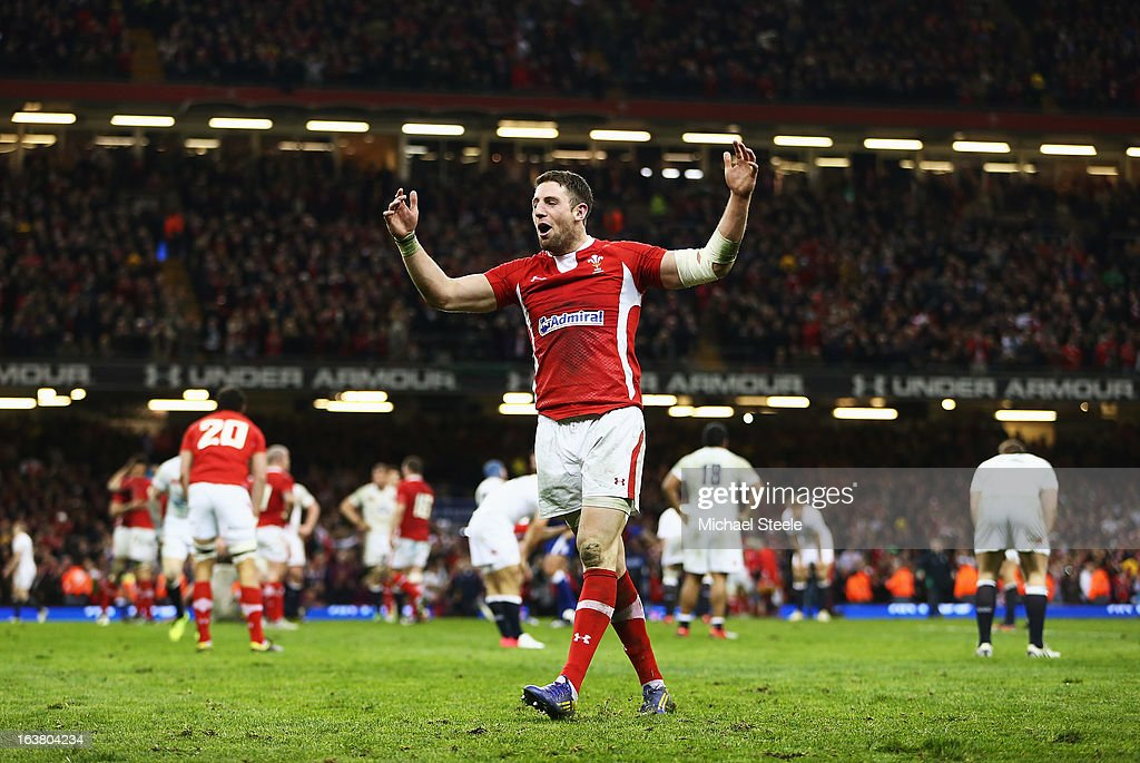 Alex Cuthbert of Wales celebrates winning the Championship after the RBS Six Nations match between Wales and England at Millennium Stadium on March...