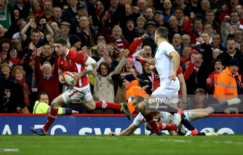 Alex Cuthbert of Wales goes past Mike Brown and Danny Care of England to score his team's second try during the RBS Six Nations match between Wales...