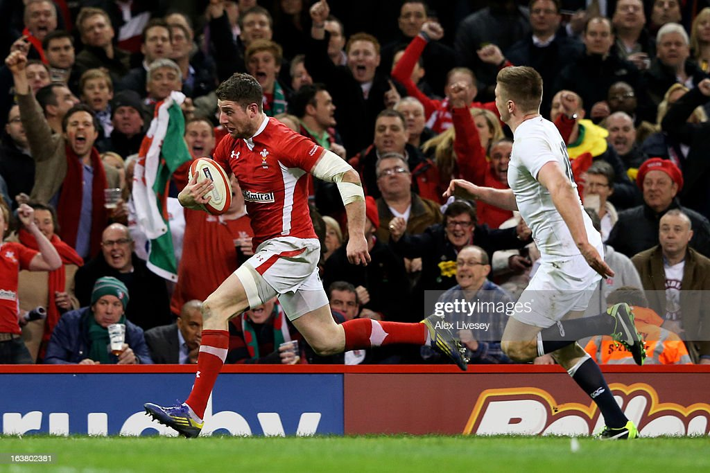 Alex Cuthbert of Wales goes past Owen Farrell of England to score the opening try during the RBS Six Nations match between Wales and England at...