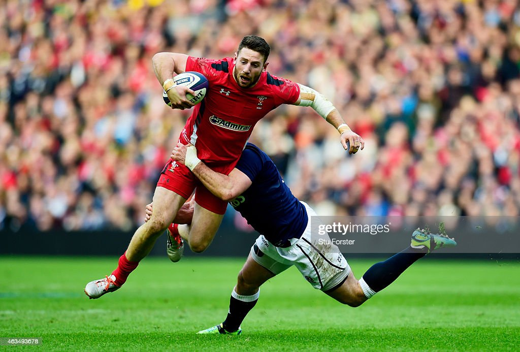 Alex Cuthbert of Wales is tackled by Alex Dunbar of Scotland during the RBS Six Nations match between Scotland and Wales at Murrayfield Stadium on...