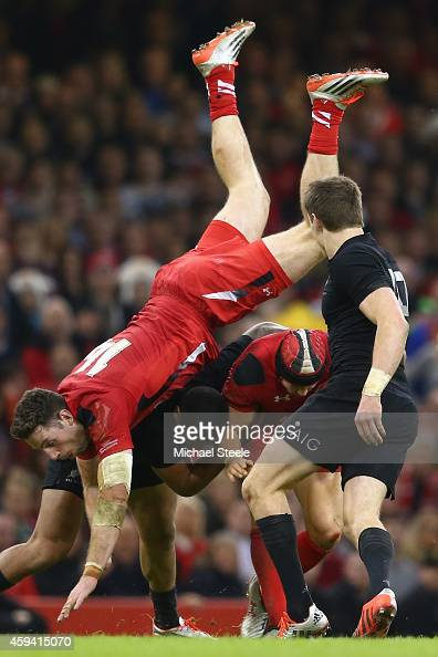 Alex Cuthbert of Wales lands awkwardly as Leigh Halfpenny gathers possession during the International match between Wales and New Zealand at the...