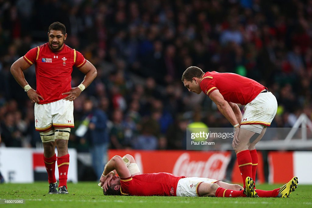 <a gi-track='captionPersonalityLinkClicked' href=/galleries/search?phrase=Alex+Cuthbert&family=editorial&specificpeople=6143846 ng-click='$event.stopPropagation()'>Alex Cuthbert</a> of Wales lies dejected on the pitch as <a gi-track='captionPersonalityLinkClicked' href=/galleries/search?phrase=George+North&family=editorial&specificpeople=7320853 ng-click='$event.stopPropagation()'>George North</a> of Wales stands over him with <a gi-track='captionPersonalityLinkClicked' href=/galleries/search?phrase=Taulupe+Faletau&family=editorial&specificpeople=12444794 ng-click='$event.stopPropagation()'>Taulupe Faletau</a> of Wales looking on during the 2015 Rugby World Cup Quarter Final match between South Africa and Wales at Twickenham Stadium on October 17, 2015 in London, United Kingdom.