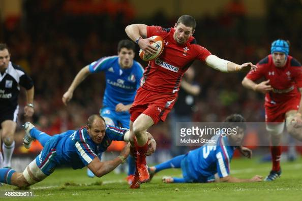 Alex Cuthbert of Wales powers his way past Sergio Parisse of Italy during the RBS Six Nations match between Wales and Italy at the Millenium Stadium...