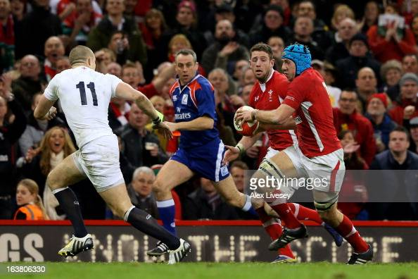 Alex Cuthbert of Wales prepares to receive the try scoring pass from teammate Justin Tipuric to score his team's second try during the RBS Six...